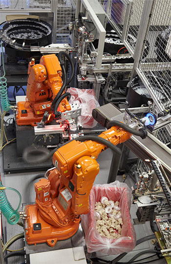 Robot-assisted Molding and Assembly Automation